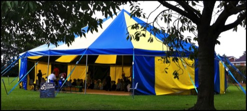 One of our beautiful blue and yellow circus style tents for hire for any event.