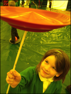 Plate Spinning in a Circus skills workshop at a School  with our Big Top